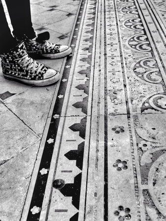 generation y: Modern sneakers contrasted with an ancient floor
