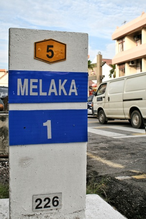 highway sign: Milestone showing distance to Melaka  Malacca