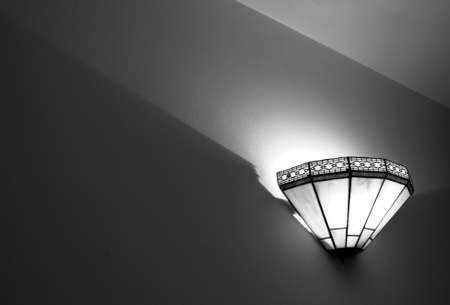 sconce: Black and white imagee of a mission style wall sconce Stock Photo