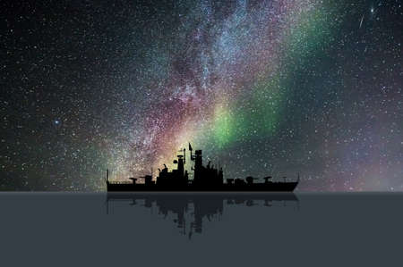 ww2: Starry Night with a battleship on the ocean Stock Photo