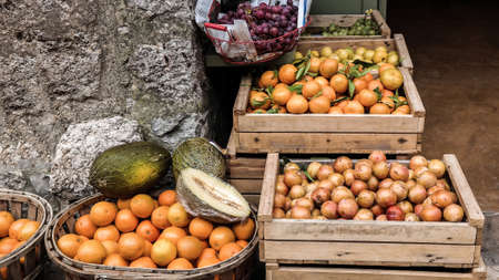 nautral: wooden crates with oranges and other fruits outside of a store Stock Photo