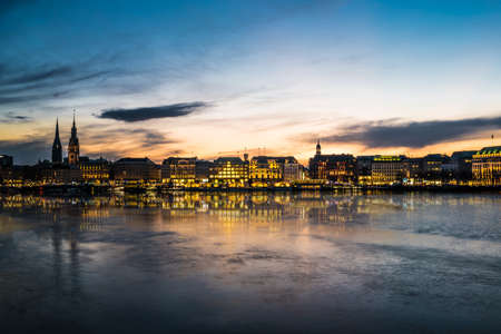 Hamburg cityscape with Alster Lake at sunset panorama 免版税图像