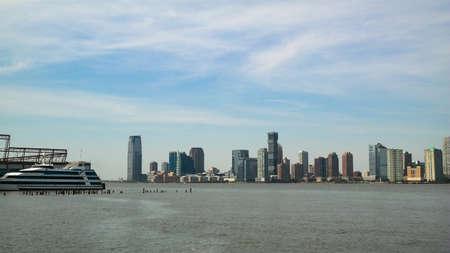 New York City, New York, USA 05.29.2016 Jersey City skyline and part of Pier 40 on Hudson River seen from Pier 45, Manhattan