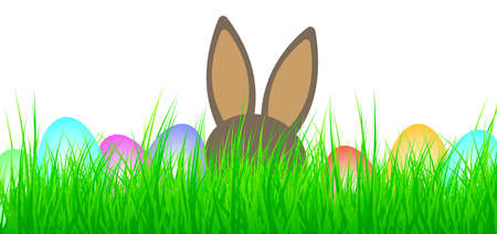 colored easter eggs and easter bunny in lush green grass Stock Photo