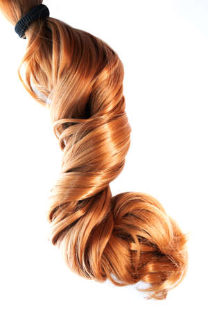 long strawberry blond hair ponytail isolated on white background