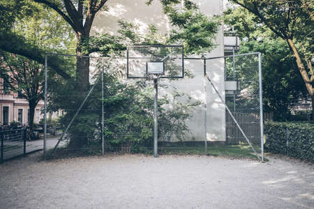 fenced in basketball court in residential neighborhood