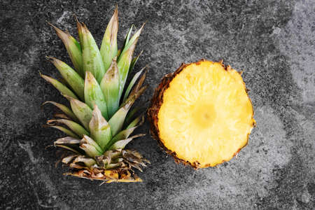 top view of pineapple sliced open on stone background