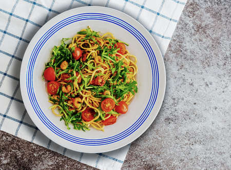 pasta plate with spaghetti with scampi, rucola and dried and fresh tomatoes Reklamní fotografie