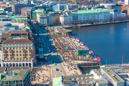 aerial view of Alster lake with crowded Jungfernstieg in Hamburg on sunny day Redakční