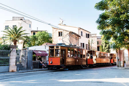 historic tram in Soller town center on sunny day