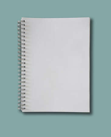spiral-bound blank page notepad on blue background