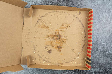 empty pizza delivery box on kitchen counter or table