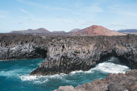 volcanic coast at Los Hervideros on Lanzarote, Canary Islands on sunny day