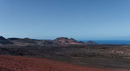 volcanic landscape in Timanfaya national park on the island of Lanzarote against clear blue sky Banque d'images