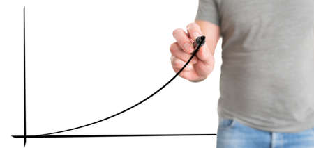 man in casual clothing drawing exponential curve, business success concept 写真素材