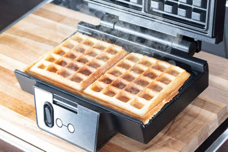 high angle view of preparing homemade belgian waffles in waffle maker 免版税图像