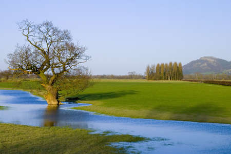 meandering: Floodwaters meandering in a Welsh border plain