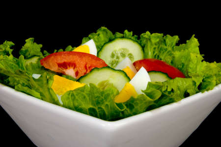 Bowl of salad isolated on a white background photo
