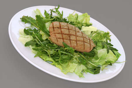 Griddled steak served on a fresh green rocket and iceberg salad photo