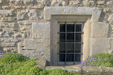 elizabethan: Basement window architectural abstract from 16th Century manor house Stock Photo