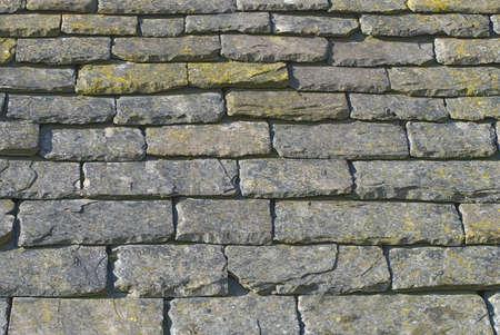 slate roof: Detail of weathered slate roof