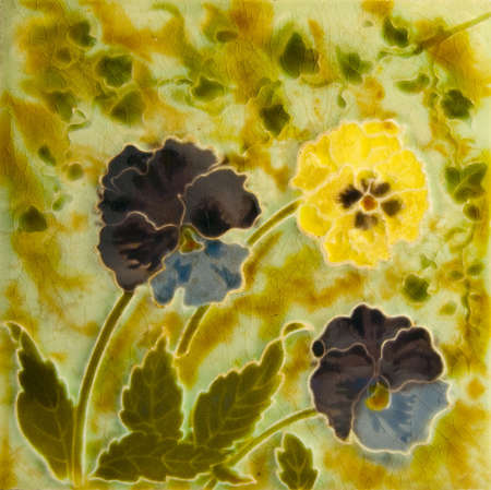 majolica: A Victorian Art Nouveau period tile c1890 in majolica glaze with pany flowers
