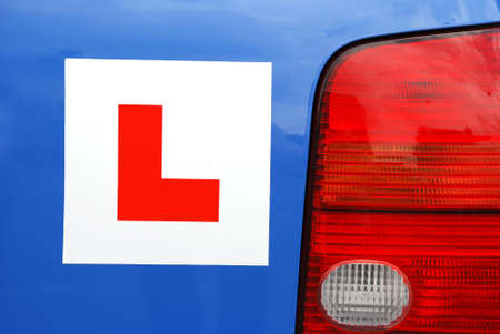 new driver: L Plate on Vehicle Rear Stock Photo