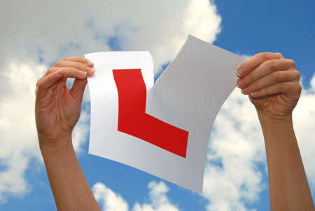 driving school: Woman Ripping L Plate