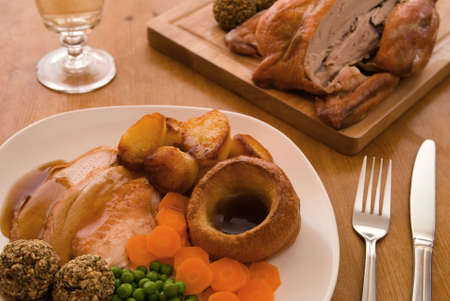gravy: Roast chicken meal in a table setting