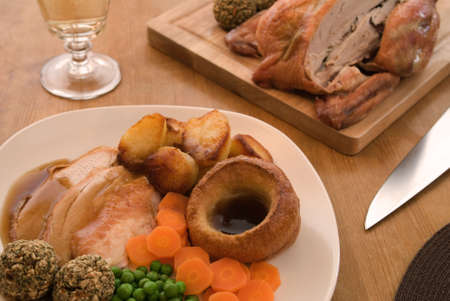 Roast chicken in a table setting photo
