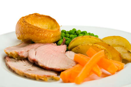 Roast lamb dinner with vegetables and Yorkshire pudding