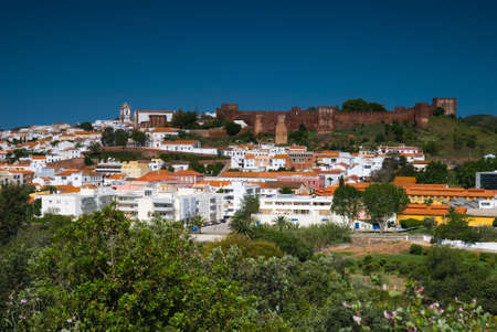 whitewashed: Silves in the Algarve region of Portugal, skyline dominated by the Moorish castle and Cathedral