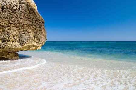 region of algarve: A section of the idyllic Praia da Marinha beach on the southern coast of the Portuguese Algarve region.
