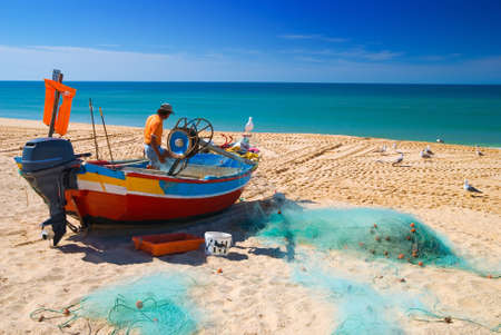 Fisherman on the beach at Arma��o de P�ra, Algarve, Portugal