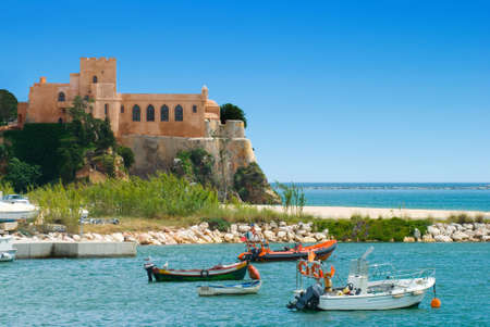 The ancient port of Ferragudo, Portugal showing part of harbour and fortifications
