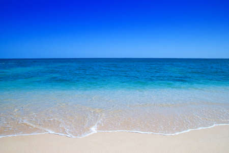 Gentle waves breaking over an idyllic beach Stock Photo - 3109415