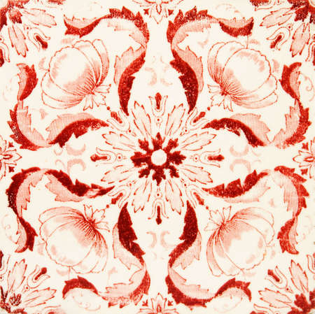 An early Art Nouveau printed tile in a blood red colour