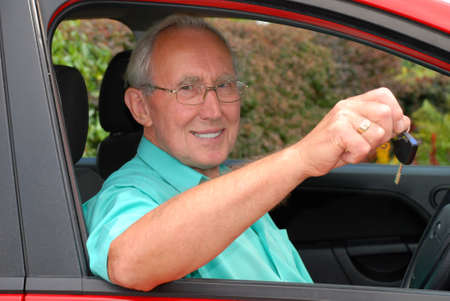 test passed: Never too late to learn - a senior man passes his driving test and gets the keys to his car.