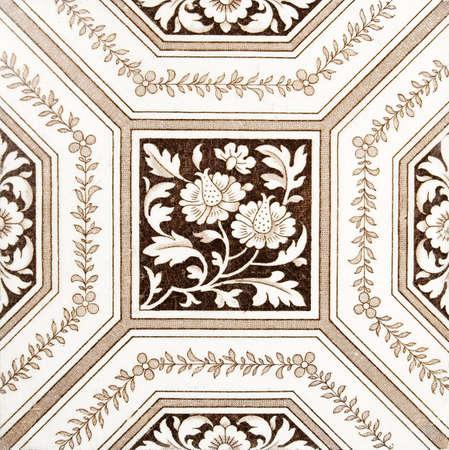 splashback: An antique, Victorian period tile from a splashback panel