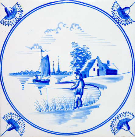 An old Dutch Delft blue & white scenic tile dating circa 1820 Stock Photo