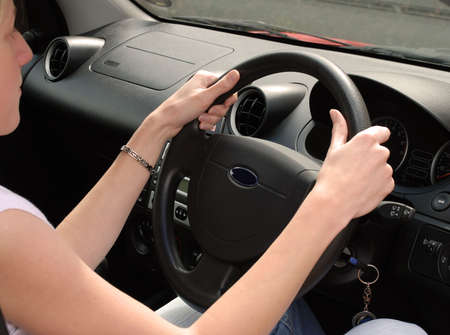 concentrating: Young woman driving, concentrating on the Road