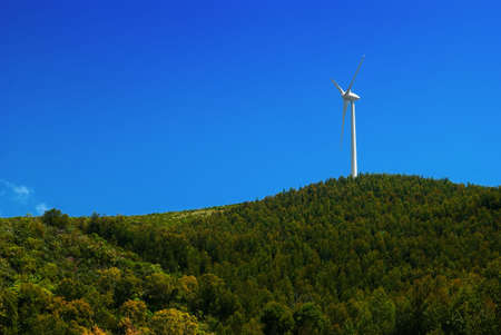 Wind turbine windmill on a hill under a blue sky Stock Photo - 3323250