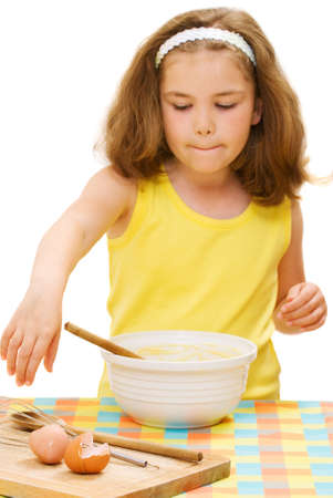 Young girl making cakes in the kitchen photo