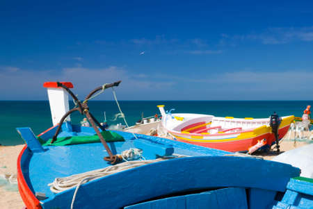 View from wooden fishing boats looking out over the Mediterranean Sea photo