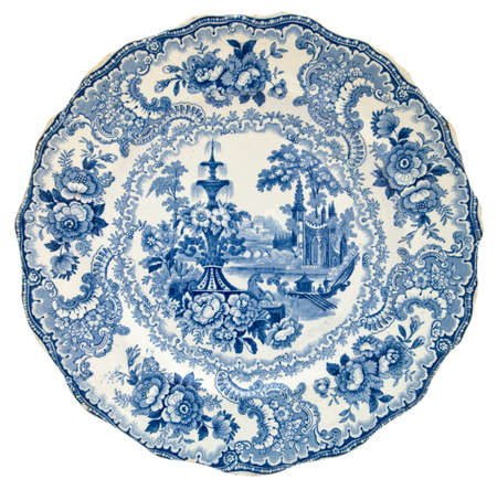 porcelain: A Staffordshire blue & white transfer printed plate with a classical design c1850 - genuine antiques series Stock Photo