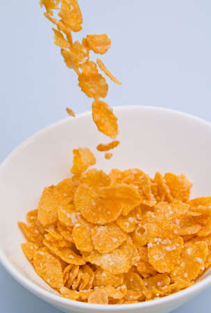 cornflakes: Cornflakes being poured into a bowl