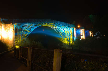 industrial heritage: Abraham Derbys historic Ironbridge lit up at night Stock Photo