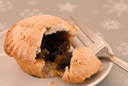 Mince pie with fork on white plate photo