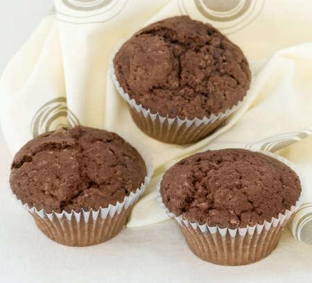 Three Chocolate Muffins freshly baked photo