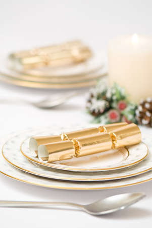 Christmas table setting with lit candle photo